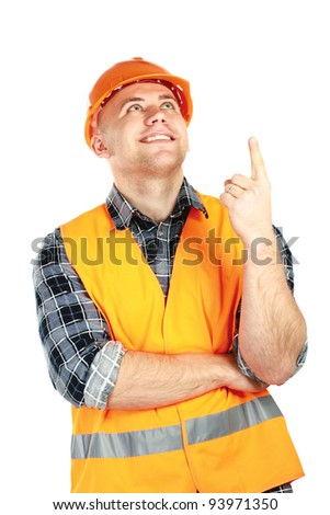 A young construction worker pointing something, isolated on white background - stock photo