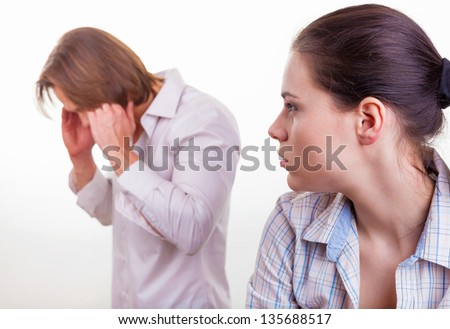 A young couple discovers the relationship on a white background - stock photo
