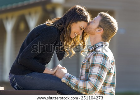 A young couple enjoy each other's company - stock photo