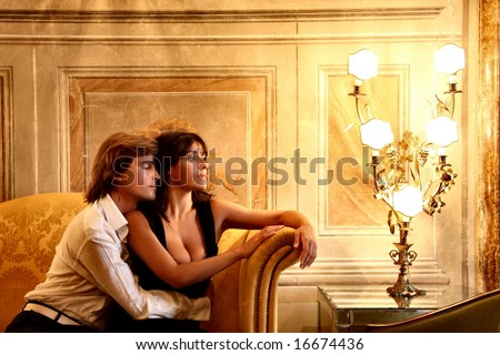 a young couple in a luxury sitting room of hotel - stock photo