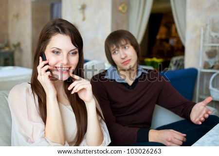 A young couple in a restaurant - stock photo