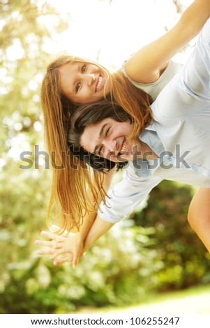 a young couple in love having fun in the park - stock photo