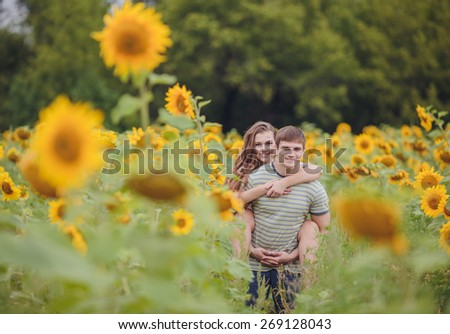 a young couple in love walking in the woods - stock photo