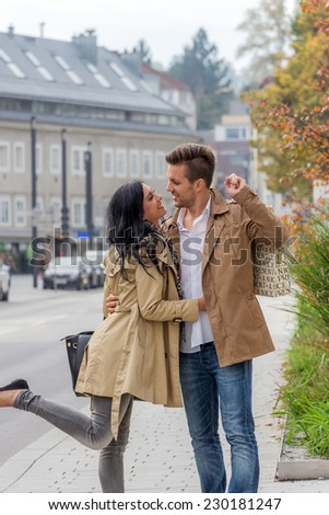 a young couple on a stroll through the city - stock photo