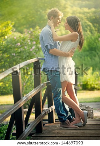 A young couple that is about to kiss. - stock photo