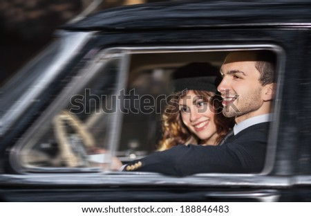 A young couple with a retro car - stock photo