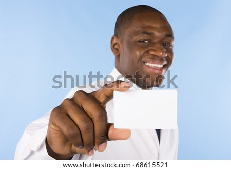 A young doctor showing his business card - stock photo