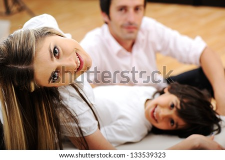 A young family at home - stock photo
