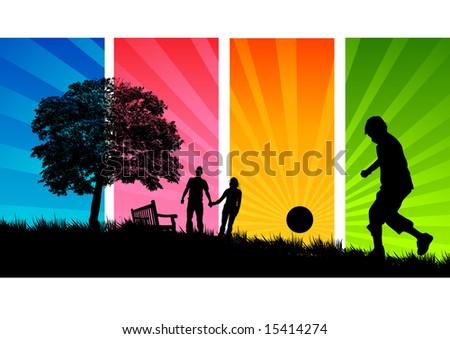 A Young family enjoy a walk through a park in summer. - stock photo