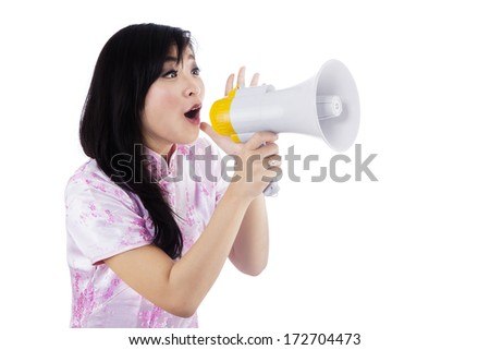 A young girl announcing chinese new year with megaphone - stock photo