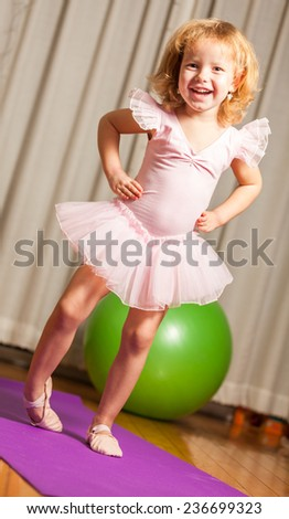 A young girl ballet dancer in a white lace tutu - stock photo