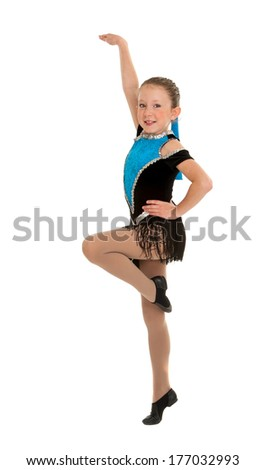 A Young Girl Dancing Jazz Mid Routine Step in Recital Costume - stock photo