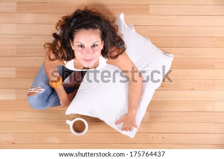 A young Girl drinking coffee. - stock photo