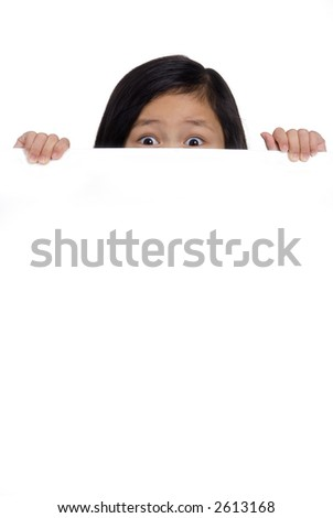 A young girl hold up a blank board and peeks over the top. - stock photo