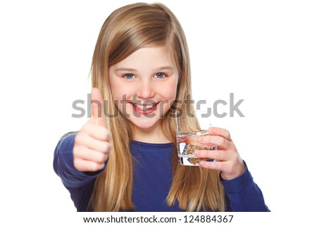 a young girl holding a glass of water and giving thumbs up - stock photo