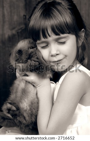 A young girl holding her bunny - stock photo