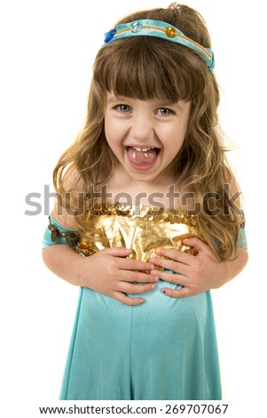 A young girl in a costume with a funny expression on her face. - stock photo