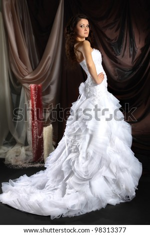 A young girl in an elegant wedding dress - stock photo