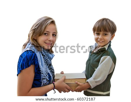 A young girl pass the book a little boy. - stock photo