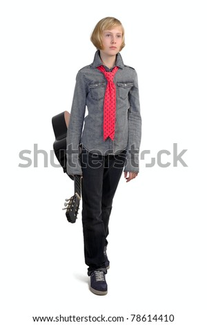 A young girl playing guitar - stock photo