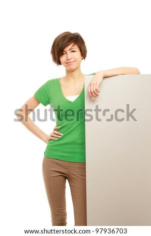 A young girl with a blank isolated on white background - stock photo