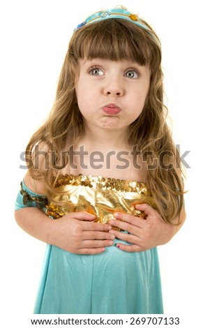 a young girl with a puckered lips and big cheeks in her costume. - stock photo