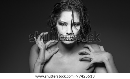 a young girl with creative face paint - stock photo