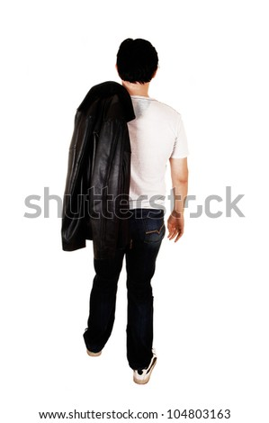 A young handsome man with a black leather jacket walking from the back in the studio for white background. - stock photo