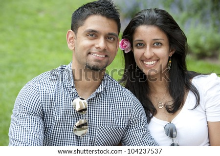 A young happy couple on a beautiful sunny day. - stock photo