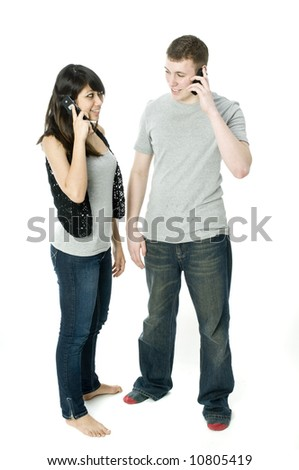 A young happy couple on the phone to each other - stock photo