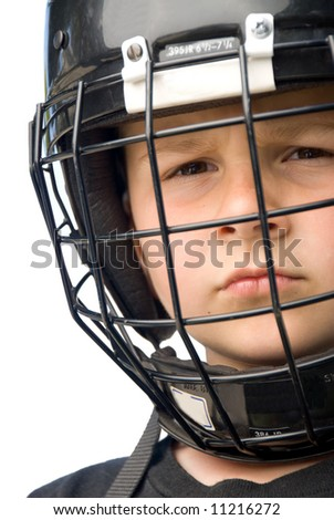 A young hockey player with is face protected helmut glares a tough attitude into the camera. - stock photo