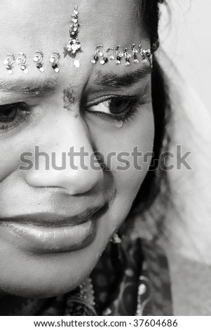 A young Indian bride crying - stock photo