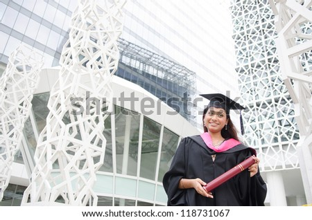 a young indian female graduate during her convocation day. - stock photo
