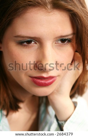 A young lady gazes out on the world in a pose reminiscent of old Hollywood shots. - stock photo