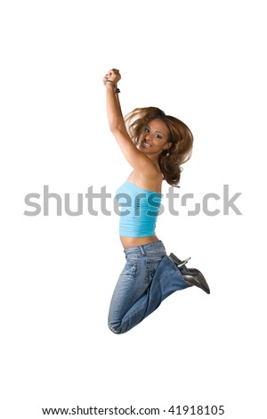 A young Latina woman jumping in the air with her knees bent isolated over a white background. - stock photo
