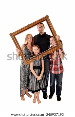 A young lovely family standing for white background and holding a picture frame in front of them.  - stock photo