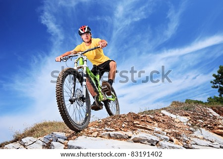 A young male riding a mountain bike outdoor - stock photo