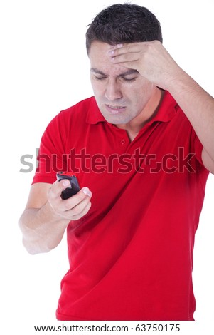 a young man angry and yelling at the phone - stock photo