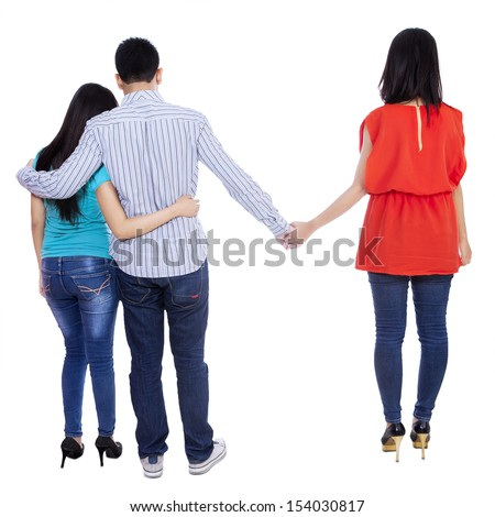 A young man cheating with another woman isolated over white background - stock photo