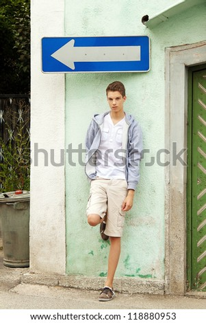 a young man considering what decision he should make - stock photo