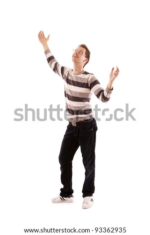 A young man, hands up isolated on white background - stock photo