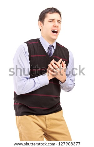 A young man having a heart attack isolated on white background - stock photo