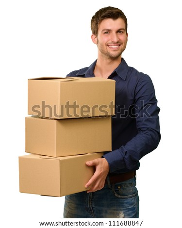 A Young Man Holding A Stack Of Cardboard Boxes On White Background - stock photo