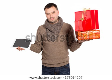 A young man holds a lot of boxes with gifts isolated on white background. Man holding gifts and electronic tablet. Red boxes and I Pad a gift. Bought a gift for your favorite. Space for text.  - stock photo