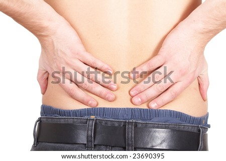 A young man holds back with both hands in pain. Isolated over white. - stock photo