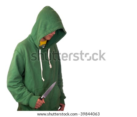 A young man in a hoodie holding a knife symbolising youth crime - stock photo