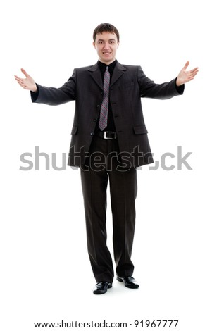 A young man in a suit, welcomes, isolated on a white background. - stock photo