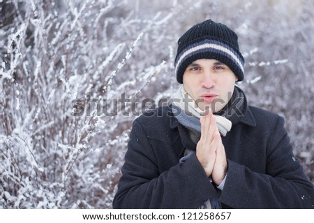 A young man is cold in the winter - stock photo