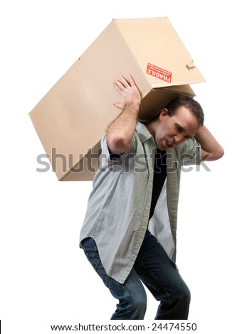 A young man lifting a large heavy box, isolated against a white background - stock photo