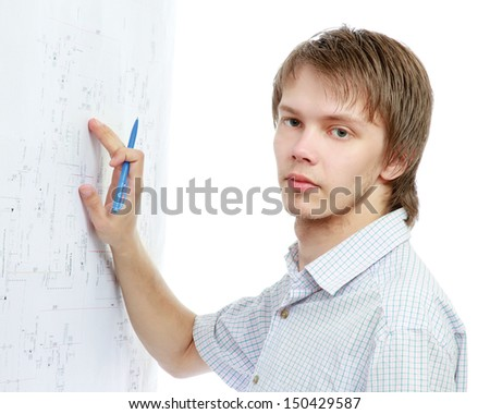 A young man near a diagram isolated on white background - stock photo